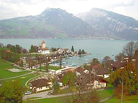 Spiez: castle and town at the shores of Lake Thun seen from the railway station